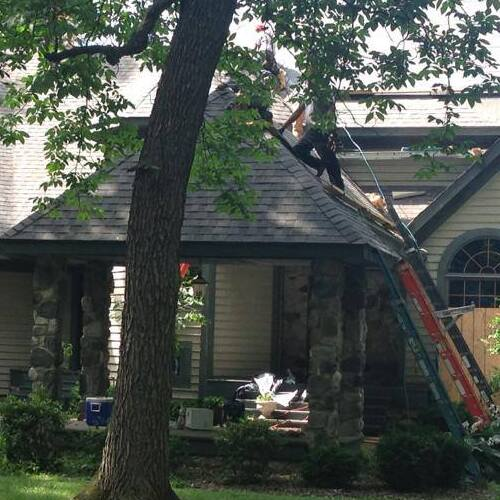 Roofers Work on Roof Repairs.