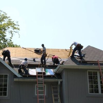 Roofers Work on a Shingle Roof Replacement