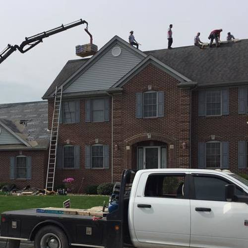residential roofers on the top of a roof