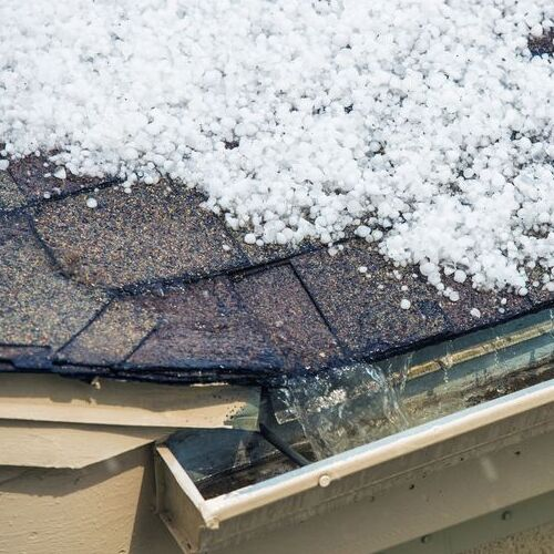 A Roof Covered in Hailstones damage that can be handled by a residential roofer