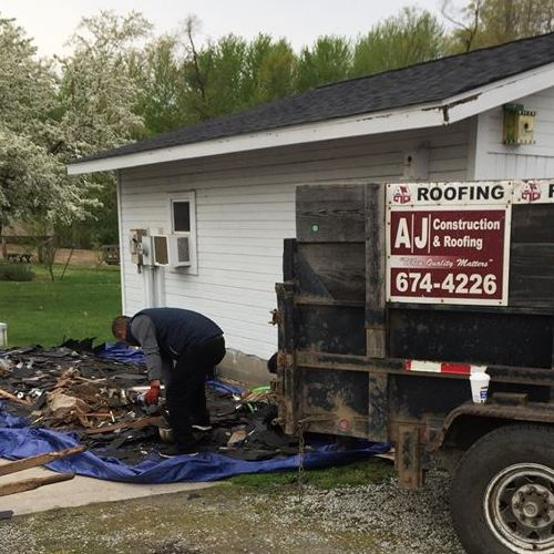 Roofers Clean Up After a Job.