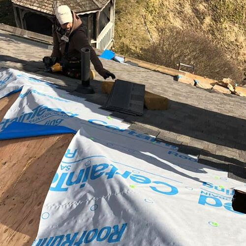 A Roofer Works on a Roof Installation.